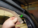 One typical problem with the door seals is the decorative trim strip (green arrow) that sits on the seal.