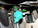 Now press the tabs (green arrows) on the electrical connector (green arrow) and pull it off the brake light switch.