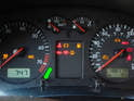 Now turn the other button (green arrow) on the instrument cluster clockwise.