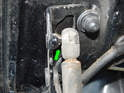 Carefully pry the trunk lid shock off the upper ball pivot by using a large screwdriver behind the attachment point (green arrow).