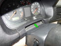 Carefully pull the trim piece (green arrow) back to release it from the dashboard.
