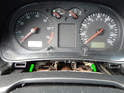 Loosen and remove the two T20 Torx screws at the bottom of the instrument cluster (green arrows).