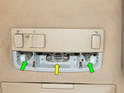 Once the cover plate is removed, you can pull the side map light bulbs (green arrows) straight out.