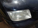 Begin by removing the headlight assembly from the car.