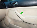 Passenger Side Door: Pull the cover for the armrest (green arrow) off.