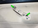 Passenger Side Door: Loosen and remove the two Phillips head screws (green arrows) shown here.