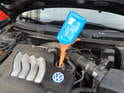 Now use a funnel to fill the engine with new synthetic oil.