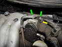 Loosen and remove the two hose clamps (green arrows) and pull the vacuum lines off the fittings leading into the throttle body.