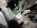 Once the serpentine belt has been removed, loosen and remove the three 13mm bolts (green arrows) holding the tensioner to the engine.