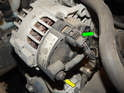 Move to the rear of the alternator and remove the plastic cover (yellow arrow) over the positive lead with a pair of pliers.