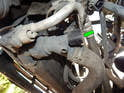 Locate the radiator drain valve at the lower right side of the car.
