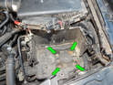 Loosen and remove the four 10mm bolts (green arrows) holding the bottom of the battery box to the chassis.