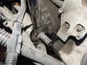 Use a 24mm wrench to loosen and remove the oil pressure sender from the oil cooler/adapter.