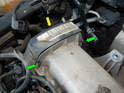 Pop open the clips (green arrows) holding the timing belt cover (yellow arrow) to the valve cover.