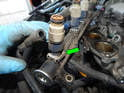 Turn the fuel rail over and you'll see the mounting clip (green arrow) that secures the injector to the fuel rail.