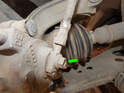 Loosen and remove the 13mm banjo bolt (green arrow) holding the end of the front brake line to the brake caliper.