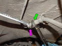 Now use a 15mm wrench (green arrow) to hold the brake line as you loosen the 11mm flare nut fitting (purple arrow).