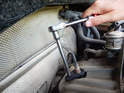 Remove the pre catalytic converter sensor from the exhaust using the oxygen sensor socket.