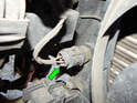 The radiator fan switch is located on the lower right hand side of the radiator on the engine bay side (looking towards rear of car).