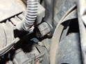 Use a 27mm box end wrench to loosen the switch from the radiator.