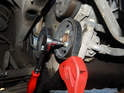 use a strap wrench to counter hold the pulley while you remove the three 5mm bolts holding the pulley to the pump.