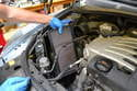 Pull the old filter from the housing using care not to drop any of the dust and dirt into the engine compartment.