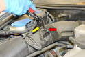 Use a set of pliers and release the clamp that holds the MAF to the intake tube (red arrow) and then use a T27 Torx and remove the two screws holding the MAF to the airbox (yellow arrow, one shown).