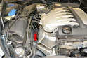 Even though the motor in our Touareg vehicle is listed as a V six both exhaust manifolds are located on the right side of the engine and the O-2 sensors are attached to the manifolds (red arrow).