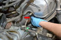 Attach the wrench to the sensor making sure it is completely seated (red arrow).