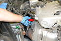 Remove the three bolts holding the heat shield to manifold bracket and remove the bracket (red arrow).