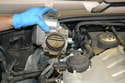 Disconnect and remove the throttle body, please see our article on throttle body removal for additional assistance.