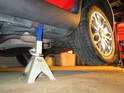 Both sides of car: Shown here is the car resting on the jack stand in front of the rear wheel.