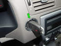 Put the key in the ignition and turn it to the second position (green arrow).