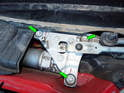 Now loosen and remove the three 8mm bolts (green arrows) holding the drive motor to the chassis.