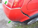 Left and Right sides of car: Once the sides of the bumper cover are free, continue pulling the bumper cover out from both under the taillight and also the top of the lower trim panel (green arrows).