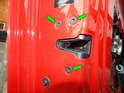 Loosen and remove the three T30 Torx screws holding the door latch to the inner door frame.