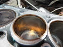 Be sure to clean out any dirt or debris that has fallen in each open cylinder before re-fitting the cylinder head.