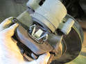 Left and Right Sides - Here is the brake bad removed from the caliper piston.