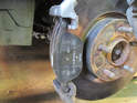 Left and Right Sides - Remove the other brake pad from the caliper frame if it hasn't already fallen out.