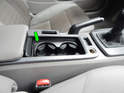 Open the center console cover and pull the drink holder (green arrow) up and out of the center console.