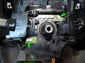 Note the electrical connectors on the steering column (green arrows).