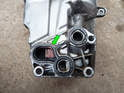 When fitting the new oil filter housing, take note of the seal (green arrow) between the housing and the block.