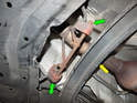 The last step is to slide the rubber hangers (green arrows) off the mounting brackets welded to the catalytic converter.