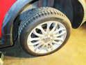 Left and Right Sides - Remove the five 19mm lug nuts holding the tire to the car and remove the wheel.