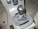 Push down on the gearshift knob and turn it counter-clockwise.