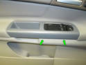 Carefully pry the door pull cover up along the bottom edge (green arrows) with a flathead screwdriver or plastic trim removal tool.