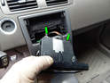 Press the tabs on the rear of the display (green arrows) and pull the head unit out of the display.