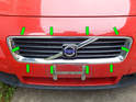 The front grille on the C30 is held in place with ten snap locks around the perimeter of the grille opening (green arrows).