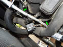 Now carefully guide the sensor wiring (green arrows) out from inside the engine bay.