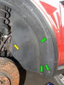Remove the three T25 Torx screws (green arrows) and the 10mm plastic nut (Yellow arrow) securing the rear of the wheel liner to the car.